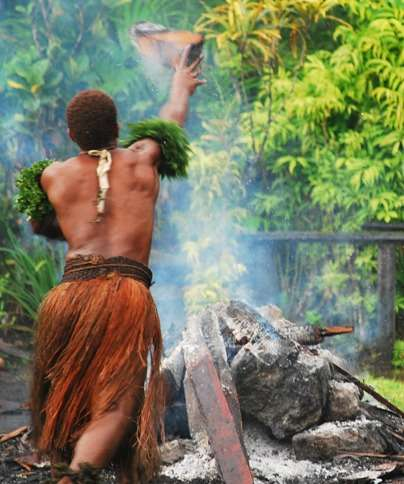 Fire Walking In Fiji Throwing Wood Off Fire fiji  photo image