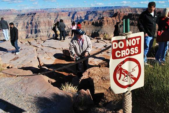 Warning Signs Useless Do Not Cross Grand Canyon united states  photo image