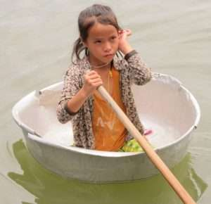 Water Transport - Floating Washing Bucket and Little Girl Paddling in Cambodia