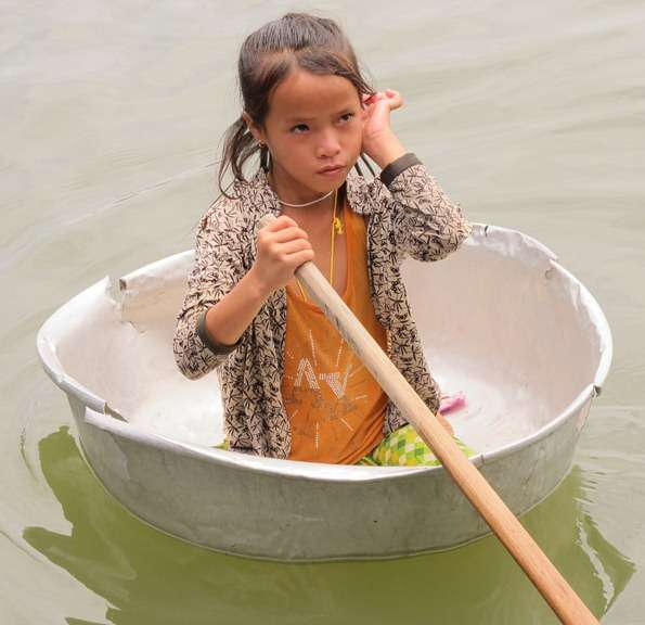 Water Transport Floating Washing Bucket and Little Girl Paddling in Cambodia1 cambodia  photo image