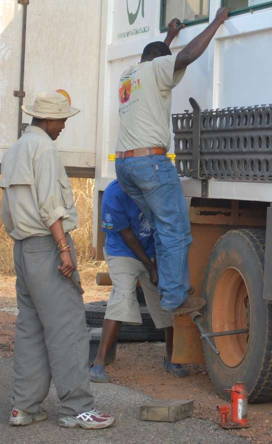 Overland Truck Fixing a Tyre