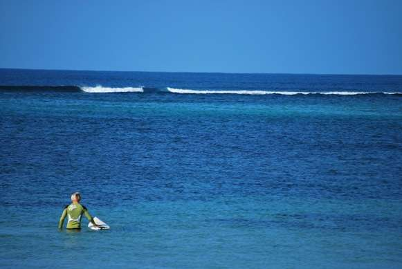 Paddling Out To Surf in Fiji