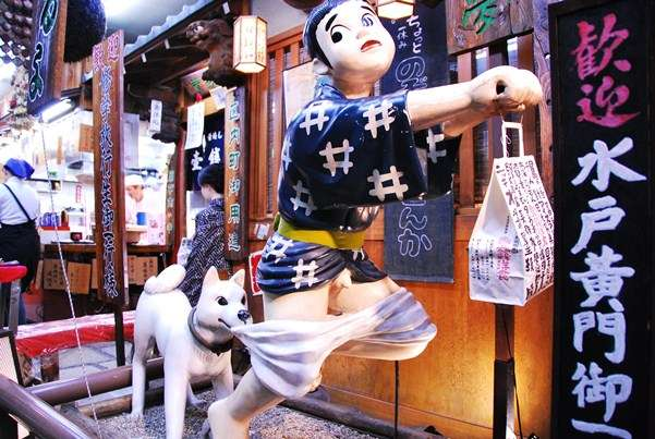 funny japanese statue caught with pants down the travel