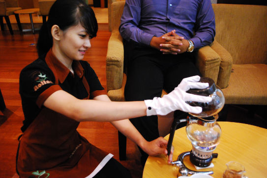 Staff at Rollaas Cafe Making Kopi Luwak Coffee